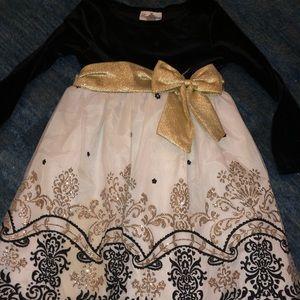 New black velvet and white and gold party dress